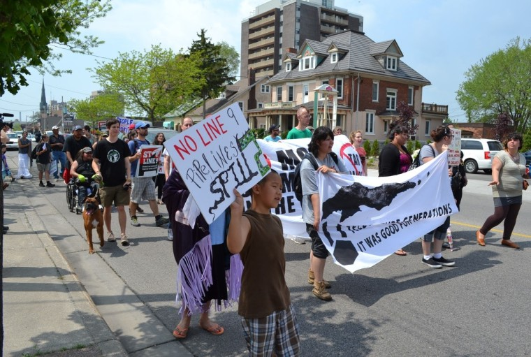 a march of people against Enbridge's Line 9