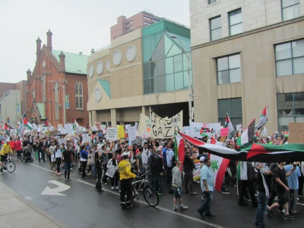 people marching at a rally for Gaza